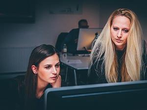 2 women scanning their business