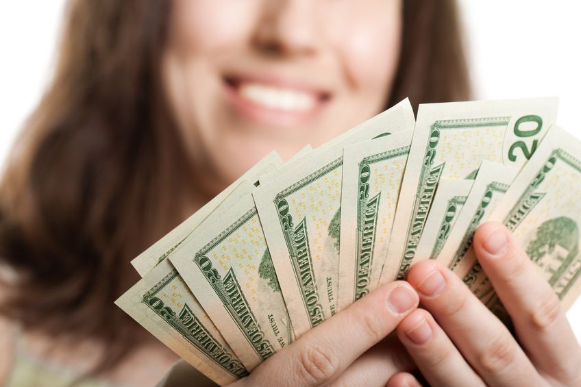 woman holding money from virtual fundraising