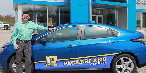 Packerland Websites owner Bill Koehne with Chevy Volt